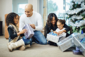 Family opening up gifts together