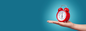 Red clock on blue background