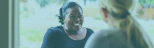 Smiling women during conversation